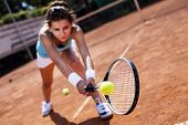 Beautiful Girl Smiling With A Tennis Racket