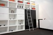 image of book-shelf  - Modern interior of white room with book cabinet - JPG