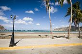 image of malecon  - malecon boardwalk beach bay on pacific ocean busy developing tourist destination of san juan del sur nicaragua with famous face of indian indio on mountain - JPG