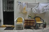 Laundry drying outside a house on a street in Corfu