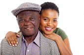 close up portrait of african daughter and senior father on white background