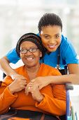 stock photo of disability  - portrait of senior african disabled woman and her caregiver - JPG