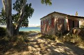 A derelict house set on the beach at Coyevinas on the Greek island of Corfu