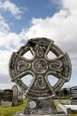 stock photo of irish moss  - an ancient celtic cross against in Irish cemetary - JPG