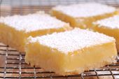 Delicious freshly baked lemon squares cooling on a wire rack
