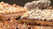 foto of toffee  - Different types of English Toffee with a variety of chocolates and nuts with a shallow depth of field - JPG