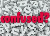 The word Confused on a background of letters to illustrate the feeling of being lost, disoriented, p
