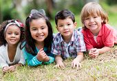 stock photo of bonding  - Happy group of kids playing at the park - JPG