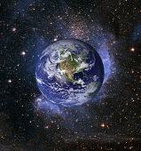 Planet Earth and stars - composited image with earth courtesy NASA satellite imagery.