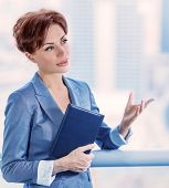 Closeup portrait of intelligent young business woman making deal, successful female at work, CEO of