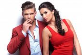 stock photo of hot couple  - smoking hot fashion couple looking at the camera - JPG