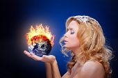 Frozen girl holding burning earth globe (east hemisphere) in palms (elements furnished by NASA) - ve