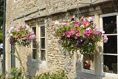Cottage With Hanging Flower Baskets. Wiltshire. England