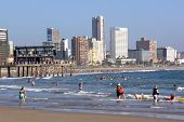 Swimmers And Sun Worshipers On Sunny Beach In Durban South Africa