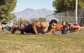 foto of boot camp  - Outdoor exercise boot camp fitness group near mountain - JPG