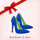 Happy Womens Day greeting card or poster design with glossy blue ladies shoe on pink background with red ribbon.