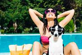 Woman On Summer Funny Vacation With Dog