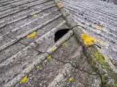 stock photo of asbestos  - roof covered with asbestos and concrete panels - JPG