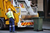 picture of trash truck  - A garbage truck driver working  - JPG