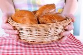 Fresh baked pasties with berries in wicker basket close-up