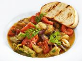 Delicious healthy backed rapana meat served with tomatoes and sweet onion in tomato sauce with toast