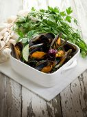 mussel soup on bowl with parsley and garlic