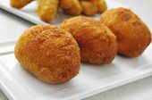 closeup of a plate with croquetas, spanish croquettes, on a set table