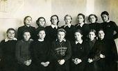 KURSK, USSR - CIRCA 1954: An antique photo shows group portrait of school graduates.