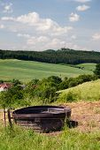 Landscape Thuringia with watering bucket