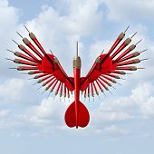 pic of goal setting  - Setting goals business concept and opportunity freedom symbol with a group of red darts in the shape of open bird wings as an icon of successful strategy vision and power on a sky background - JPG