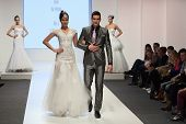 ZAGREB, CROATIA - FEBRUARY 15, 2014: Fashion models dressed as bride and groom on 'Wedding days' show