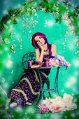 image of loach  - Beautiful young woman sitting under an arch of flowers and overgrown loach - JPG