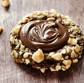 stock photo of hazelnut  - Chocolate filled cookies with hazelnuts selective focus closeup - JPG
