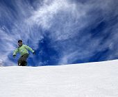Snowboarder On Off-piste Slope