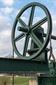 pic of pulley  - Old green painted pulley wheel of a hoisting installation at a historic sluice complex in the Netherlands - JPG