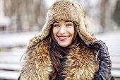 Girl smiling in fur hat and coat