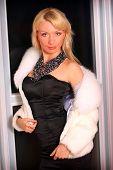 Young Woman In Short Fur Coat
