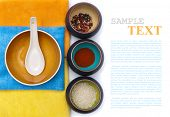 ceramic bowls with spices and rice on color placemat with sample text