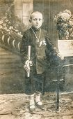 POLAND, CIRCA 1910 - Vintage photo of boy at his First Communion