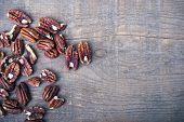 Pecan Nuts On Wood