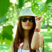 stock photo of fedora  - fashion girl outdoor portrait - JPG