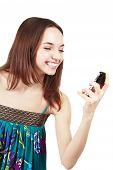 Beautiful Woman Looking At Mobile Phone