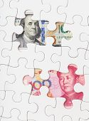 stock photo of yuan  - US dollar and chinese yuan with white puzzle - JPG