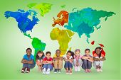 Elementary pupils smiling against green vignette with world map