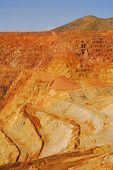 image of ore lead  - Excavated sides of open pit mine - JPG