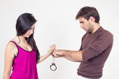 Attractive young couple with handcuffs