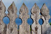 Wooden fence against dark blue sky background