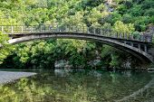 Bridge In Bright Forest Of Voidomatis River That Flows Through Epirus Region, Greece. Natural Compos