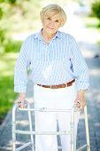 Portrait of senior patient walking outside