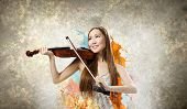 Young pretty asian woman playing violin. Young talent